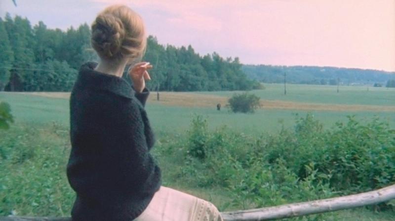 mirror-1974-003-woman-sitting-on-fence