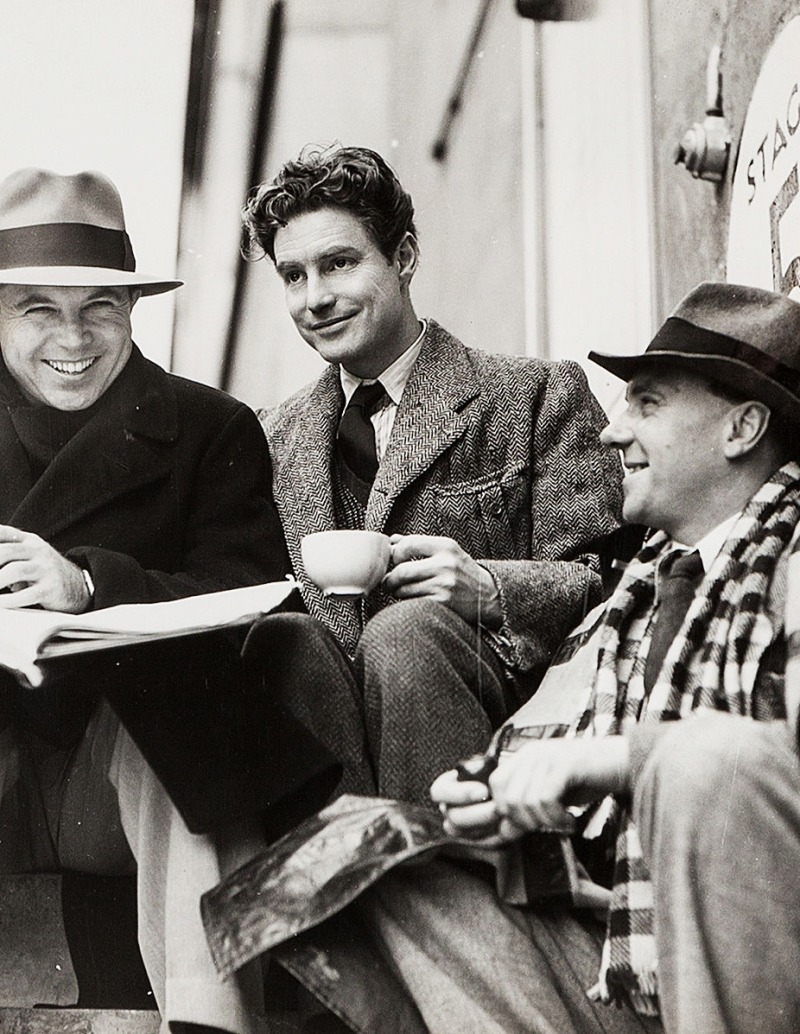 King Vidor, Robert Donat and Ralph Richardson outside the Denham sound stage during filming of The Citadel (1938)